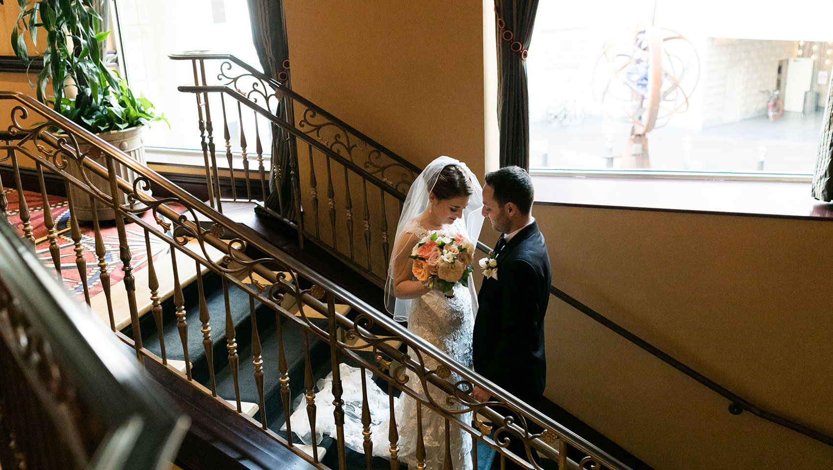 Bride and Groom on staircase in wedding attire
