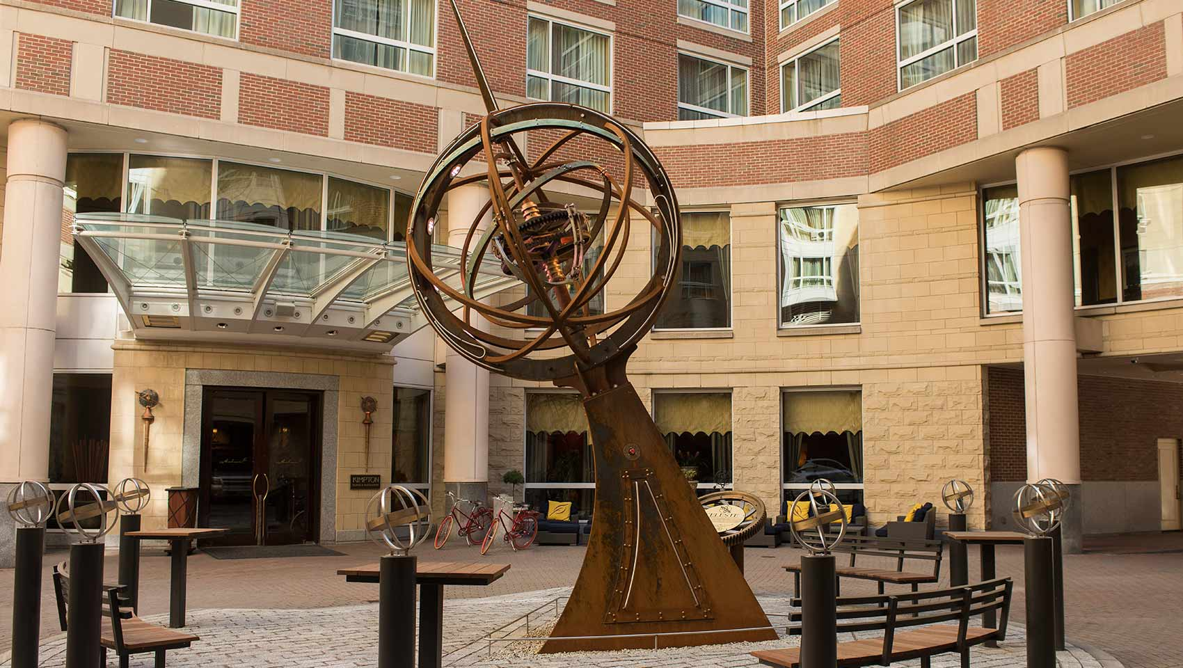 Kimpton Marlowe Hotel courtyard with sphere shaped, metal art fixture, Celeste, in the middle.