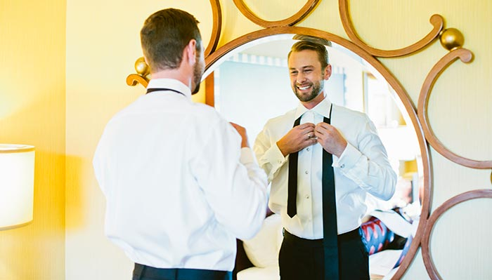 groom getting ready at kimpton Marlowe hotel