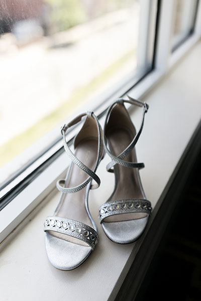 Brides wedding shoes by window