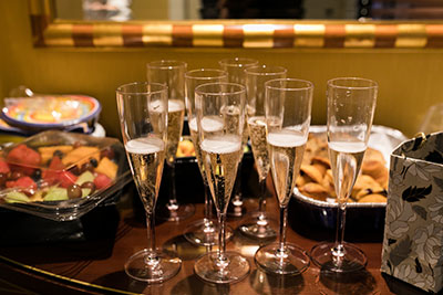 Glasses with champagne on table with snacks