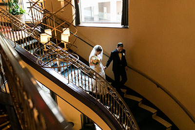 Wedding couple walking down stairs