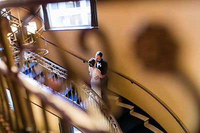 Wedding couple kissing on staircase