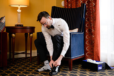 Groom adjusting socks