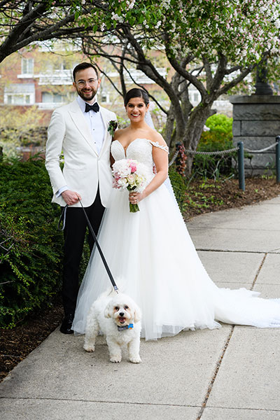 Wedding couple with small dog