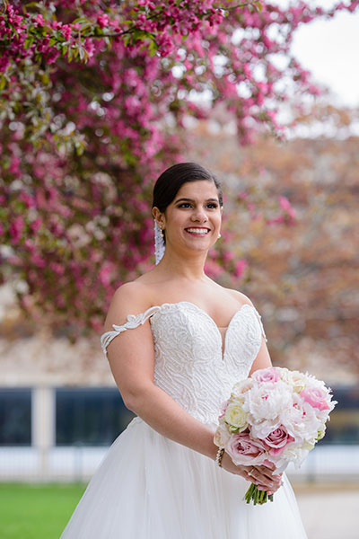Bride standing by colorful florals