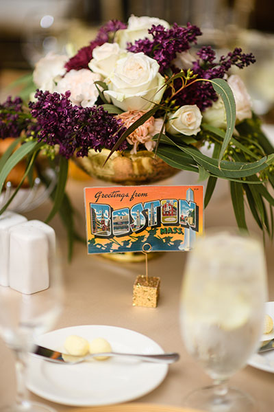 Wedding table setting with postcard