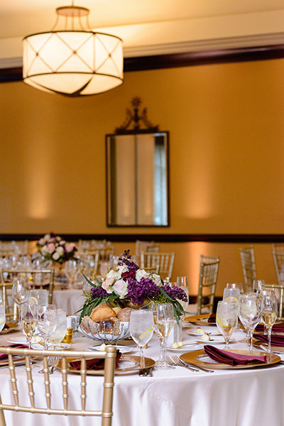 Wedding tables with centerpieces and floral arrangements