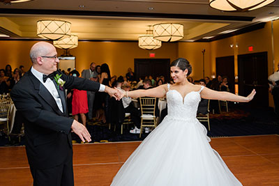 Bride dancing with man