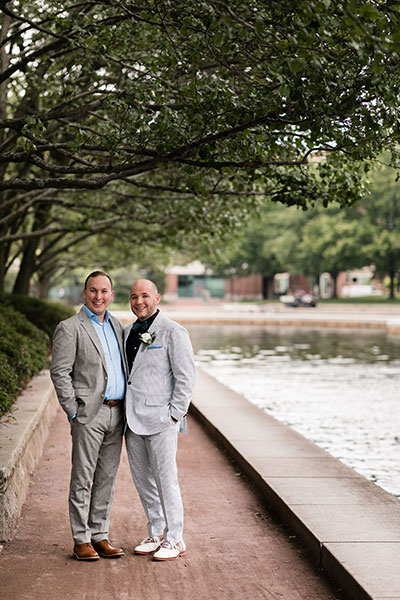 Grooms together by pond