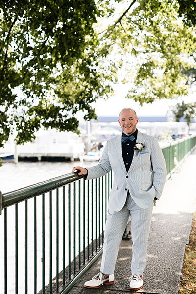 Groom by waterfront
