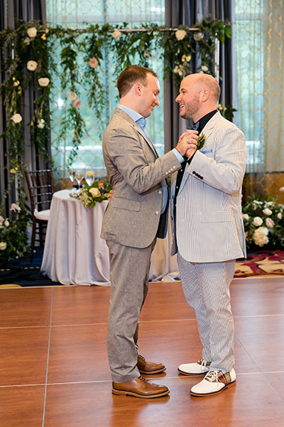 Grooms dancing together